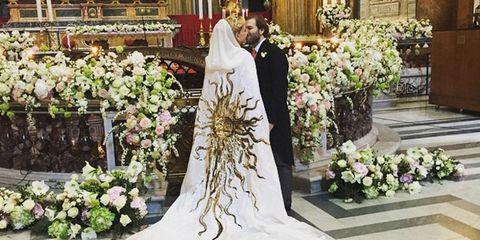 Petal, Flower, Coat, Floristry, Bouquet, Suit, Bridal clothing, Bride, Formal wear, Gown,