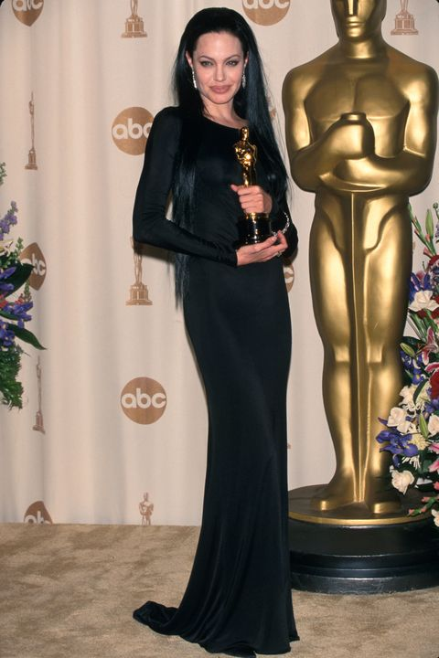 Actress Angelina Jolie, wearing black gown and holding her Oscar, in Press Room at Academy Awards.  (Photo by Mirek Towski/DMI/The LIFE Picture Collection/Getty Images)