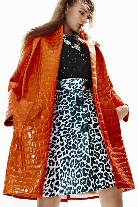 """<strong>Miu Miu</strong> coat, $3,500, sweater, $760, skirt, $2,420, and necklace, $1,415, <a target=""""_blank"""" href=""""http://store.miumiu.com/en/US"""">miumiu.com</a>."""