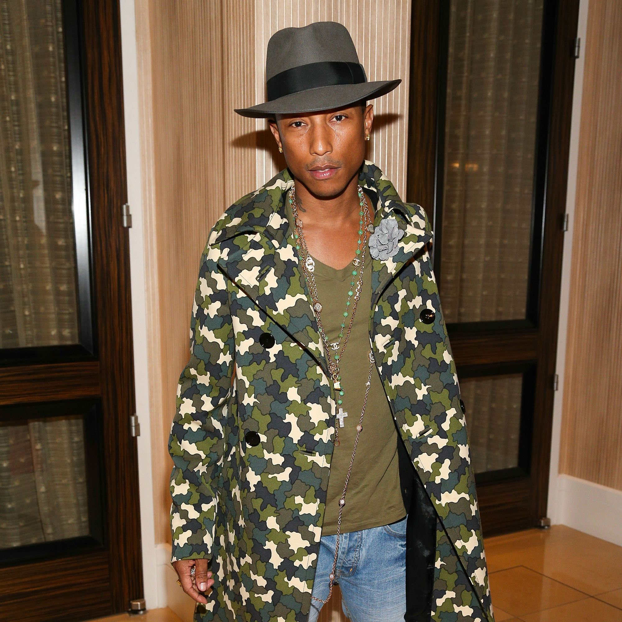 BEVERLY HILLS, CA - OCTOBER 23:  Singer/songwriter Pharrell Williams attends the STARS 2013 Benefit Gala By The Fulfillment Fund at The Beverly Hilton Hotel on October 23, 2013 in Beverly Hills, California.  (Photo by Imeh Akpanudosen/Getty Images)