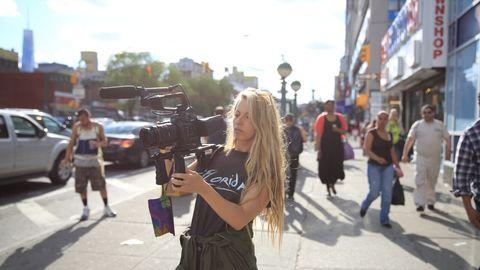 Video camera, Camera, Cameras & optics, Television crew, Street, Film camera, Videographer, Pedestrian, Camera operator, Street fashion,