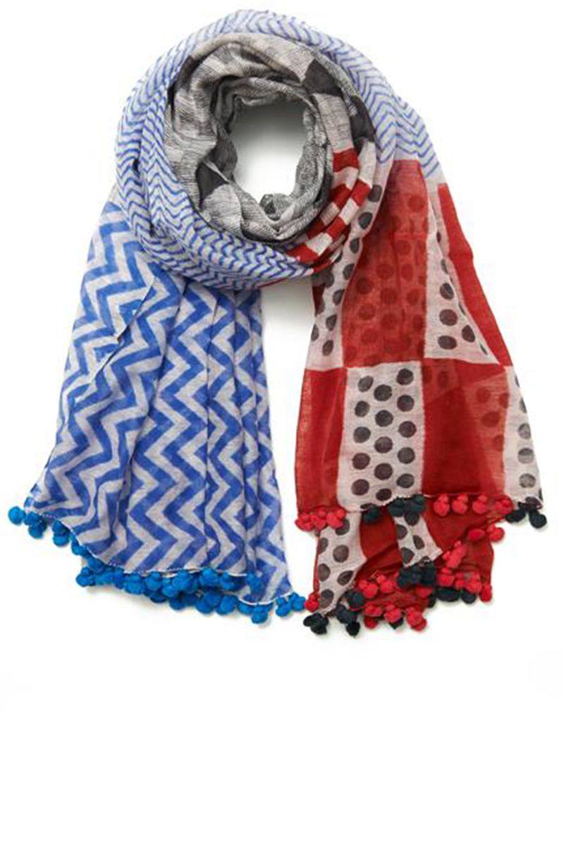 "<strong>Bungalow 8 </strong>scarf, $95, <a target=""_blank"" href=""http://shop.harpersbazaar.com/designers/bungalow-8/silk-cotton-ebele-pom-pom-scarf/"">shopBAZAAR.com</a>"