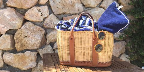 """I never leave for a holiday without my rare Hermés Wicker Garden Party Basket. It is the perfect carry-on and beach basket. My favorite sunglasses this summer are from The Row and the crochet dress is from Tabula Rasa.""   <strong>Tabula Rasa</strong> dress, $395, <a target=""_blank"" href=""https://tabularasa-ny.com/store/products/thar-kaftan-2/"">tabularasa-ny.com</a>; <strong>The Row</strong> sunglasses, $424, <a target=""_blank"" href=""http://www.matchesfashion.com/us/products/1010961?country=USA&amp;vzwty=cgid:16430022537%7Ctsid:15858%7Ccid:299464377%7Clid:90402343737%7Cnw:g%7Ccrid:66507992937%7Crnd:6700121481428331440%7Cdvc:c%7Cadp:1o3%7Cbku:1&amp;mkwid=0pmi8qzE&amp;gclid=CjwKEAjwwN-rBRD-oMzT6aO_wGwSJABwEIkJeMjbkkJYhfCBYB_DCKw3-vrjneLrClokGVQS2CNjdhoCs8fw_wcB"">matchesfashion.com</a>."