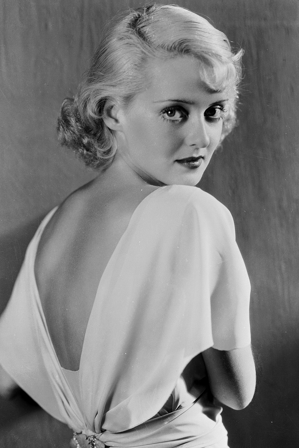1932:  American actress Bette Davis (1908 - 1989) as Madge in the film, 'Cabin in the Cotton', directed by Michael Curtiz.  (Photo via John Kobal Foundation/Getty Images)
