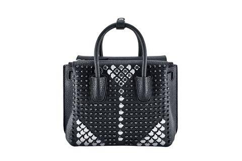 """<strong>MCM</strong> bag, $1,210, <a target=""""_blank"""" href=""""http://www.mcmworldwide.com/en/women/bags"""">mcmworldwide.com</a>."""
