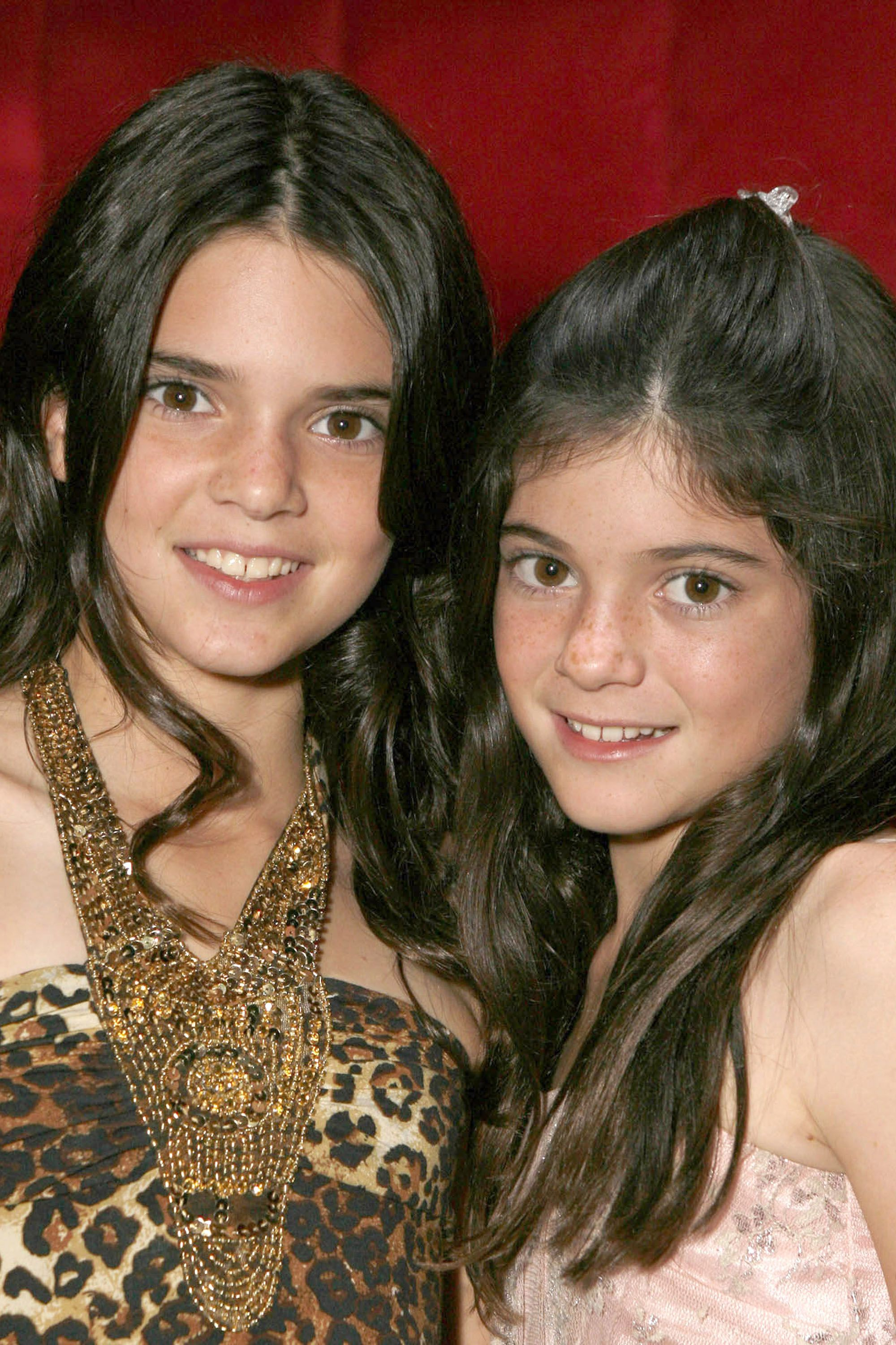 "AGOURA HILLS, CA - OCTOBER 16:  Kendall Jenner and Kylie Jenner pose for a photo at the ""Keeping Up With the Kardashians"" viewing party at Chapter 8 Restaurant on October 16, 2007 in Agoura Hills, California.  (Photo by Jeff Vespa/WireImage)  *** Local Caption ***"