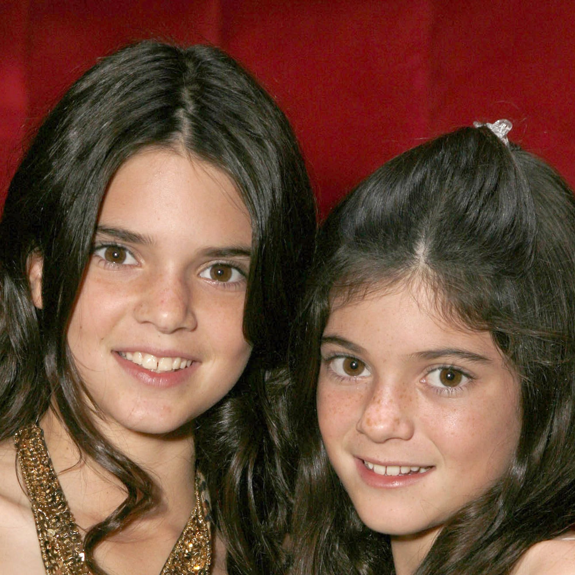 """AGOURA HILLS, CA - OCTOBER 16:  Kendall Jenner and Kylie Jenner pose for a photo at the """"Keeping Up With the Kardashians"""" viewing party at Chapter 8 Restaurant on October 16, 2007 in Agoura Hills, California.  (Photo by Jeff Vespa/WireImage)  *** Local Caption ***"""