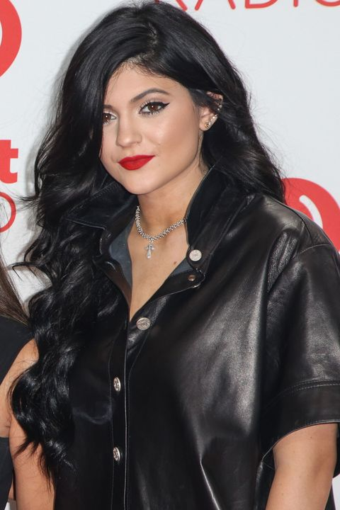 2013Darker black hair and a matte red lipstick in 2013.
