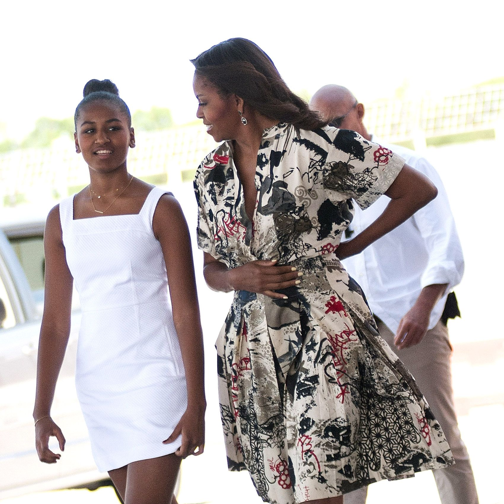 VENICE, ITALY - JUNE 21:  First Lady Michelle Obama leaves with daughters Malia Obama and Sasha Obama (L) on June 21, 2015 in Venice, Italy. Michelle Obama has travelled to Italy where she is expected to speak about her 'Let's Move' initiative to combat childhood obesity.  (Photo by Awakening/Getty Images)