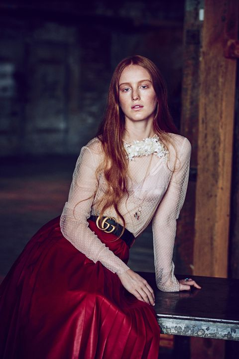 """Whispers of """"Who is that girl?"""" were overheard in March at Chanel's New York City reshowing of the Métiers d'Art Collection. The idiosyncratic redhead of interest had seemingly been plucked out of obscurity by the label's It girl scouts to sit alongside Eve Hewson, Dylan Penn, and Lily-Rose Depp. But unlike her front row mates, India Salvor Menuez doesn't hail from a famous family. The 21-year-old was raised in New York's Chinatown by artist parents, whom she credits with showing her """"the possibility and joyous struggle of being your own boss."""" And she wasn't overtly clad in Chanel. """"I shop secondhand."""" Her reasoning: """"It's better for the planet.""""  By 15, Menuez already had a presence on the city's art scene as a co-founder of Luck You, a collective for young creatives. Today the multihyphenate has a hand in every arena of the arts. She generally introduces herself as an artist-cum-actress, but Menuez also counts herself a painter, sculptor, writer, filmmaker, and costume designer. Although she strategically avoids the Hollywood/pop culture spotlight, intellectual hipsters have spotted her in indie films, such as <em>Something in the Air</em>, which premiered at the 2012 Venice Film Festival, and guerrilla-style performance art pieces; her feminist group show """"Milk and Night"""" drew crowds at last year's Miami Art Basel. Widespread recognition may be unavoidable: Pharrell cast her as a model for the cover of his <em>Girl</em> album, and critics are comparing her controversial character in the upcoming indie film <em>White Girl</em> to Chloë Sevigny's 1995 breakout role in <em>Kids</em>. And, of course, there is that Chanel front row."""