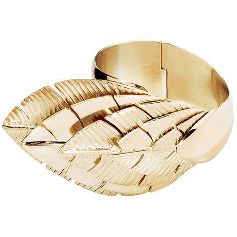 """<p><em>Aurelie Bidermann cuff, $1,105, </em><a href=""""https://shop.harpersbazaar.com/designers/a/aurelie-bidermann/talitha-gold-plated-cuff-4629.html"""" target=""""_blank""""><em>shopBAZAAR.com</em></a></p>"""