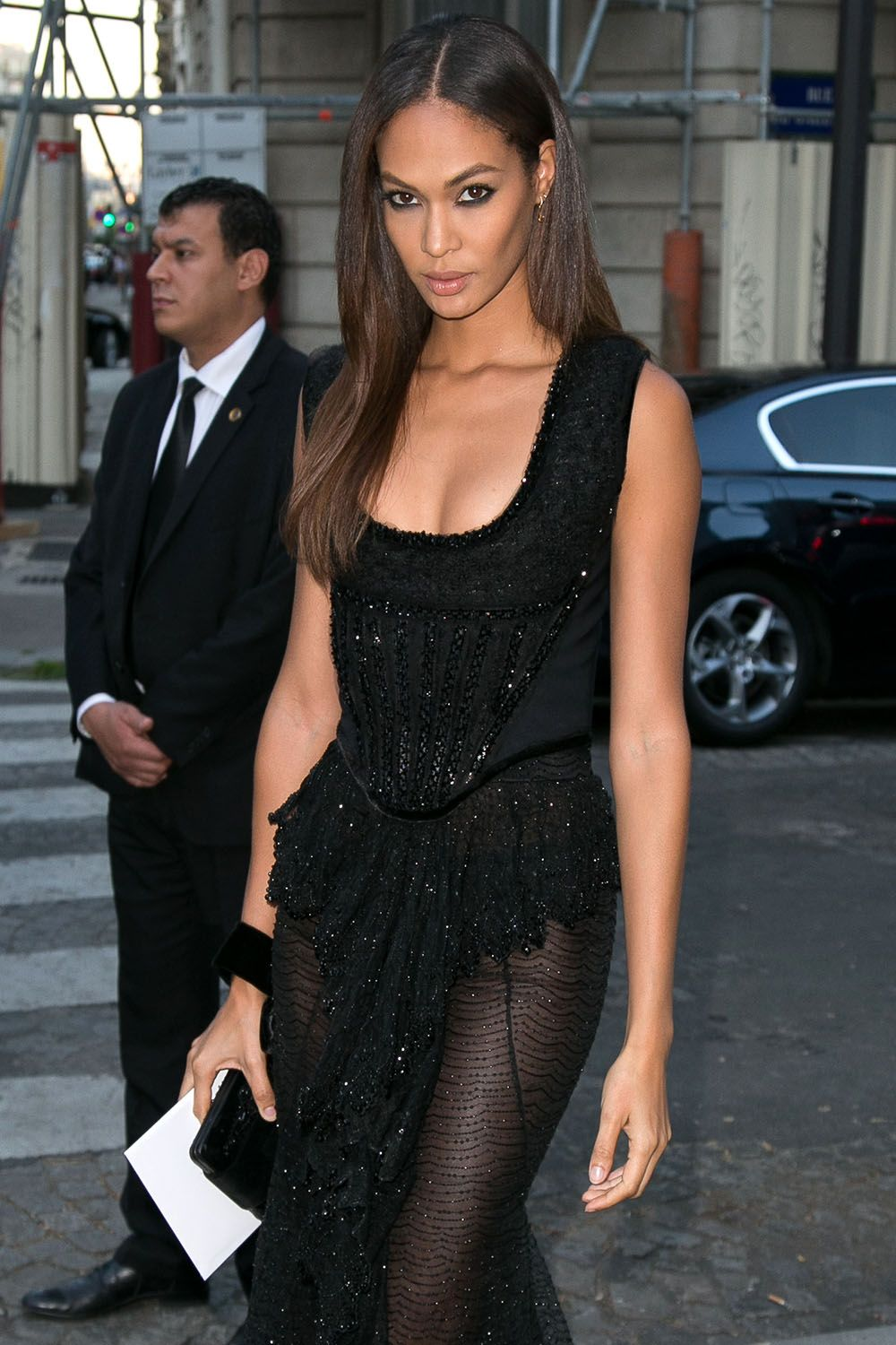 Why experiment with color when Joan Smalls proves just how sexy all black everything—from smudgy liner to sequins to your clutch—can be?