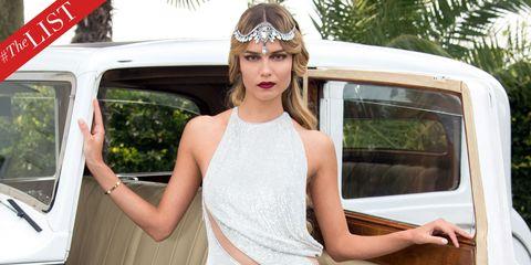 Shoulder, Hand, Automotive exterior, Vehicle door, Dress, Headpiece, Hair accessory, Sleeveless shirt, Tiara, Chest,