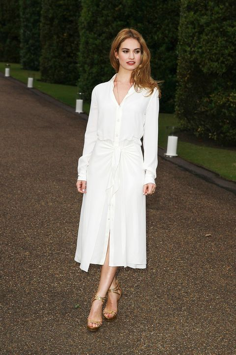 <p>Lily James is lovely in a manicured garden in Ralph Lauren Collection.</p>