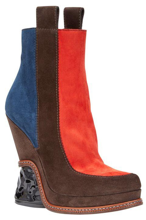 "<p><em>Fendi bootie, $1,150, <a href=""http://www.fendi.com/us/woman/shoes/view-all.html"" target=""_blank"">fendi.com</a>. </em></p>"