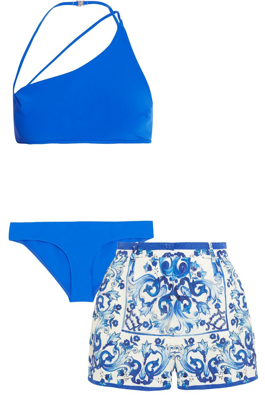 "<p><strong>Zimmermann</strong> bikini $275, <a href=""http://us.zimmermannwear.com/swim-and-resort/swimwear/hyper-bonded-asymmetric-bikini-electric.html"">zimmermannwear.com</a>; <strong>Dolce & Gabbana</strong> shorts, $1,295, <a href=""http://www.net-a-porter.com/us/en/product/567102"">net-a-porter.com</a>.</p>"