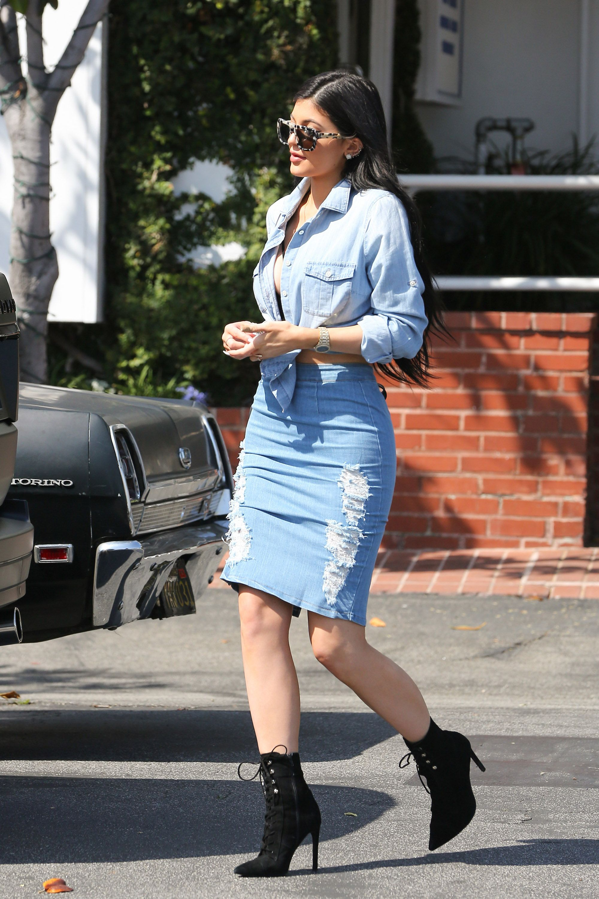 <p>Kylie in black lace-up booties </p>