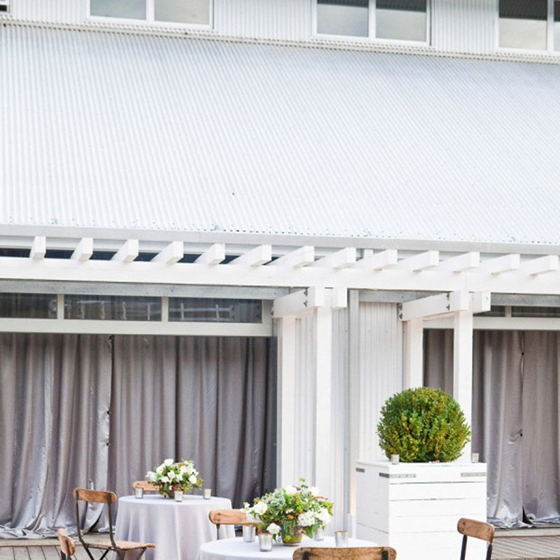 <p>Wooden chairs and neutral linens let your venue shine.</p>