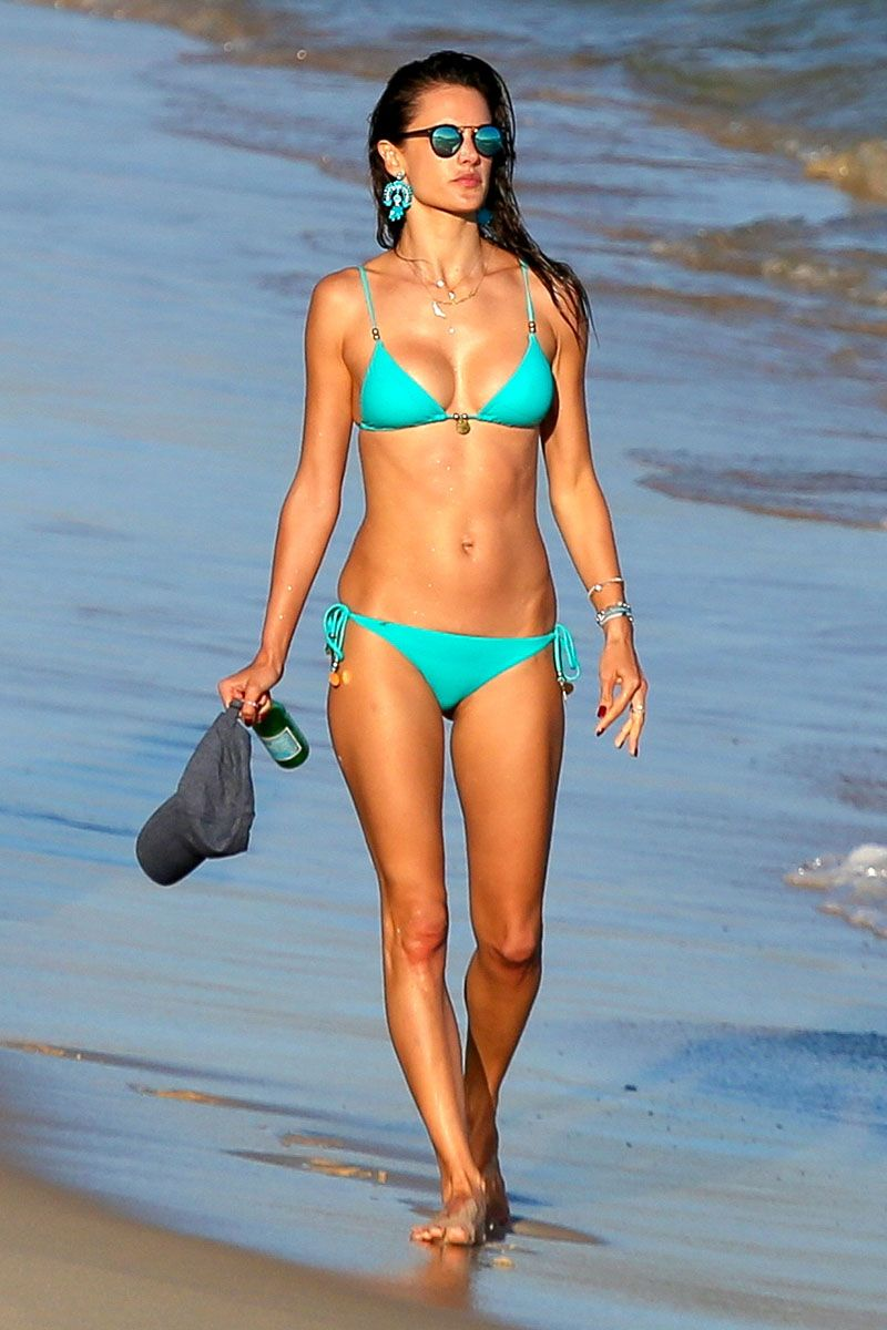 <p><strong>Where: </strong>Rio de Janeiro <br></p><p><strong>Why: </strong>The Victoria's Secret Angel makes a case for accessorizing with your bikini—adding bold turquoise earrings to her beach look. </p>