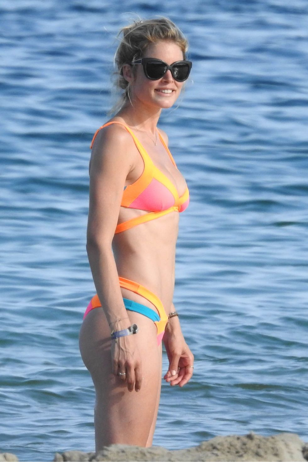 <p><strong>What: </strong>Agent Provocateur</p><p><strong>Where: </strong>Ibiza</p><p><strong>Why: </strong>Kroes channels the electric spirit of the Spanish island in an neon color-blocked bikini. </p>