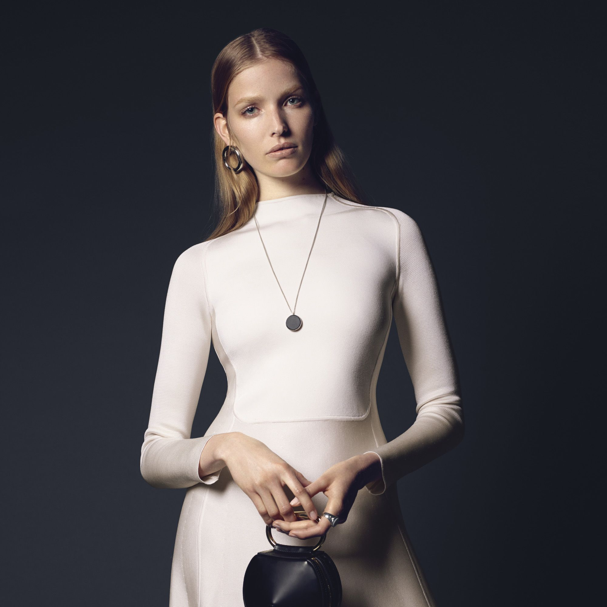 """<p><strong>Hermes</strong> dress, $5,450, <a href=""""http://usa.hermes.com/"""" target=""""_blank"""">hermes.com</a>&#x3B; <strong>J.W. Anderson</strong> earring, $365, <a href=""""http://j-w-anderson.com/"""" target=""""_blank"""">j-w-anderson.com</a>&#x3B; <strong>Tom Wood</strong> necklace, $320, and ring, $480, <a href=""""http://www.tomwoodproject.com/"""" target=""""_blank"""">tomwoodproject.com</a> &#x3B; <strong>3.1 Phillip Lim</strong> bag, $395, <a href=""""http://www.31philliplim.com"""" target=""""_blank"""">31philliplim.com</a>. </p>"""