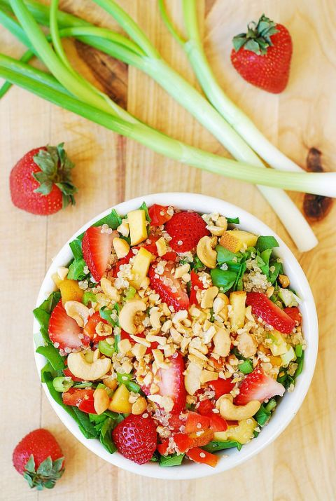 "<p>Instead of croutons, use quinoa and cashews to add some crunch.</p><p>Get the recipe from <a href=""http://juliasalbum.com/2014/07/strawberry-quinoa-spinach-cashew-salad/"">Julia's Album</a>.</p>"
