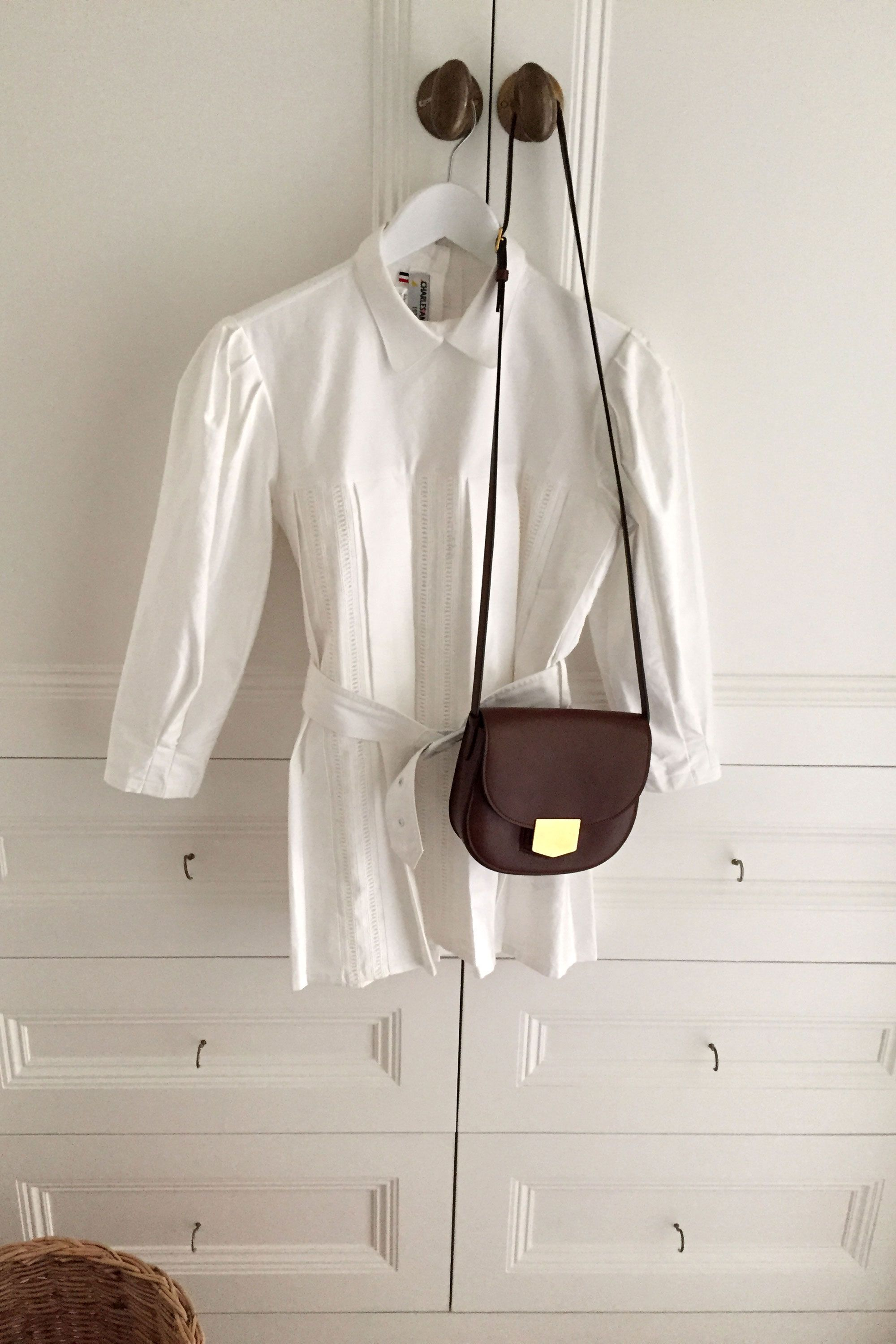 "<p>On Friday morning we set off towards the little village of Gympton in Oxfordshire where we are staying at a friend's cottage close to the festival grounds. For the journey I wear my favorite Charles Anastase blouse and Céline bag.</p><p><strong>Céline</strong> bag, $2,650, <a href=""https://www.celine.com/en/collections/fall-winter-runway-2015/leather-goods/medium-trotteur-bag-grained-calfskin/176633ZMB.07DS"" target=""_blank"">celine.com</a>, <strong>Charles Anastase</strong> blouse, <a href=""http://www.charles-anastase.com/"" target=""_blank"">charles-anastase.com</a>. <br></p>"
