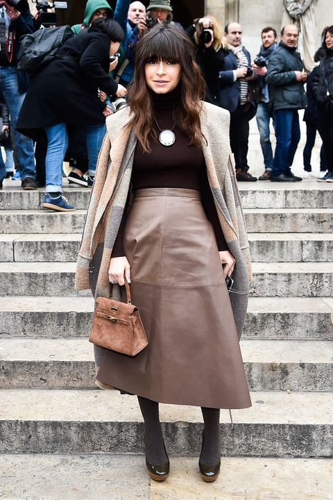<p>For maximum impact, make like Miroslava Duma and piece together the perfect fall look with a cozy patchwork topper. Layer on a gilded necklace and luxe leather extras for a polished finishing touch. </p>
