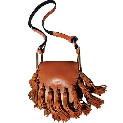 "<p>Fringe has a permanent place in Western history, but what about fashion history? It tends to ebb and flow, but right now it's certainly the <em>accoutrement du jour</em>. </p><p><strong>Chloe</strong> bag, $2,150, <a href=""https://shop.harpersbazaar.com/Needs-Attention/Mini-Hudson-Suede-Tassel-902.html"">shopBAZAAR.com</a>.</p>"