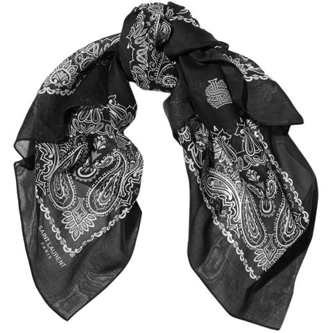 "<p>Silk scarves have always been a staple of the uptown set, but these days <a href=""http://www.harpersbazaar.com/fashion/trends/how-to/a11566/7-cool-ways-to-style-a-scarf/"">the style set is adopting them</a> and making them modern again—especially in classic bandana prints.</p><p><strong>S</strong><strong>aint Laurent </strong>scarf, $145, <a href=""http://www.net-a-porter.com/product/590732/Saint_Laurent/printed-cotton-scarf"">net-a-porter.com</a>.<span></span></p>"