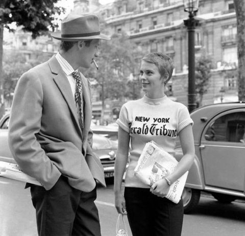 <p>Starring as a wandering French criminal's American acquaintance in Paris, Patricia (Jean Seberg) sports a short blond pixie cut, slim cut black trousers, a sweater embroidered with The New Herald Tribune logo and loafers. It's the ultimate tribute to the eclectic, casual style of American fashion in Paris during the early 60s. Poised as the cool gamine girl, at one point in the film Patricia steals her criminal companion's button-down, belts it, and wears it as her own. Her wardrobe weapon of choice? Breton stripes for days.</p>