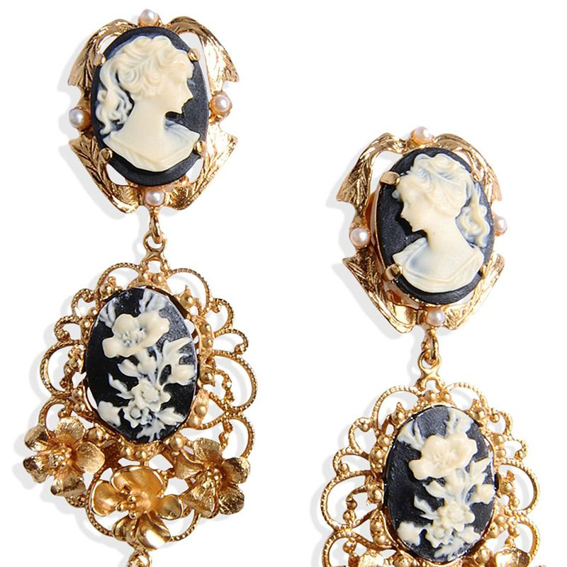 "<p><strong>Dolce & Gabbana</strong> earrings, $975, <strong><a href=""https://shop.harpersbazaar.com/designers/d/dolce-and-gabbana/cameo-faux-pearl-clip-earrings-5614.html"" target=""_blank"">shopBAZAAR.com</a></strong>.</p>"
