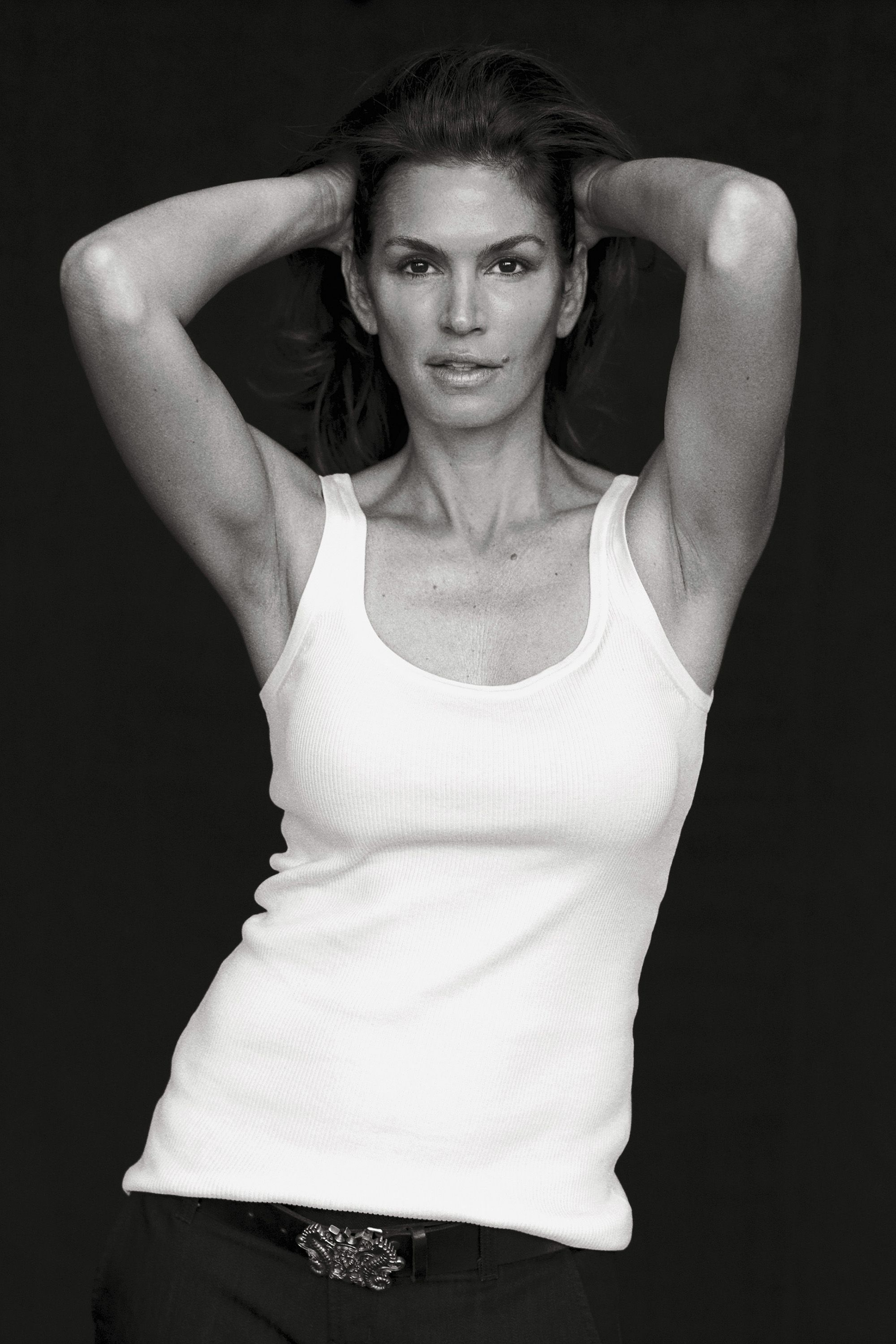 """<p><em>Photographed for the September 2009 issue by Peter Lindbergh, styled by Brana Wolf.</em></p><p><em></em>Cindy Crawford was one of the original supermodels—that handful of young women who booked nearly every cover, editorial, and major campaign in the late 1980s and early '90s. """"We worked almost every day, and the days we weren't working we were on a plane,"""" Cindy remembers. """"If I could go back, I'd try to drink it all in more."""" She says the apex of that period was her now famous strut down the Versace catwalk in 1991, when she walked arm in arm with Naomi Campbell, Linda Evangelista, and Christy Turlington to George Michael's hit """"Freedom '90."""" (They'd all appeared in the song's video.) """"That was the moment,"""" she recalls. """"It felt like the stars were in alignment.""""</p>"""