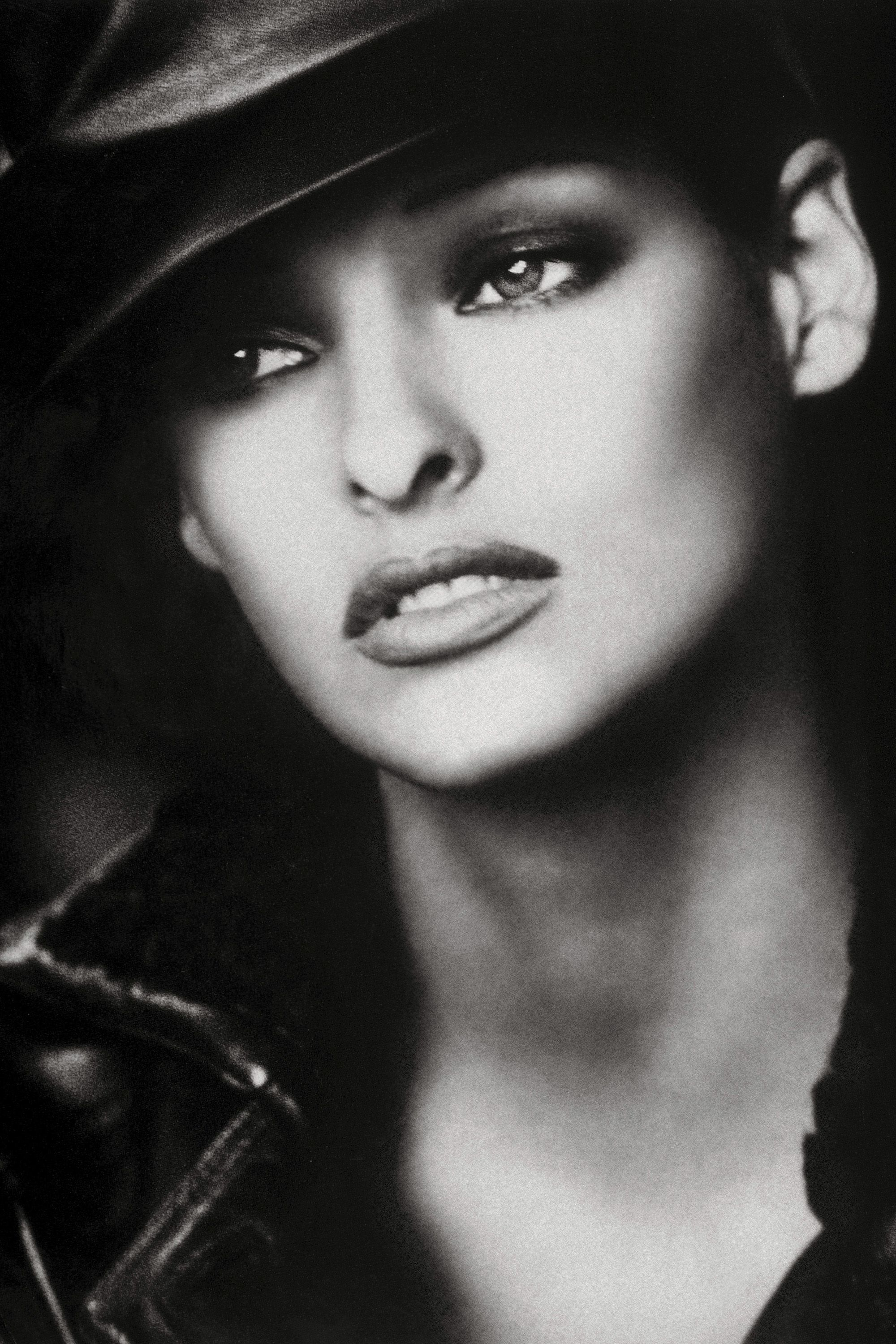 """<p><em>Photographed for the September 1992 issue by Peter Lindbergh, styled by Paul Cavaco and Tonne Goodman.</em></p><p><em></em>Fashion photographers adore working with Linda Evangelista in part because she is the industry's ultimate changeling. At one point she dyed her hair 17 times in five years. Of all the original supermodels, Linda was also the most notorious. That's due in large part to a quip she made in a 1990 interview: """"We don't wake up for less than $10,000 a day."""" Linda admits that she had her diva moments, but she was never delusional. """"I climbed the ladder very,very slowly,"""" she says. """"I remember a salon once paid me $400 to put a picture of me with a new haircut in the window, and I was ecstatic,"""" she adds. """"I never dreamed as high as the cover of <em>Bazaar.</em><span class=""""redactor-invisible-space"""">"""" </span></p>"""