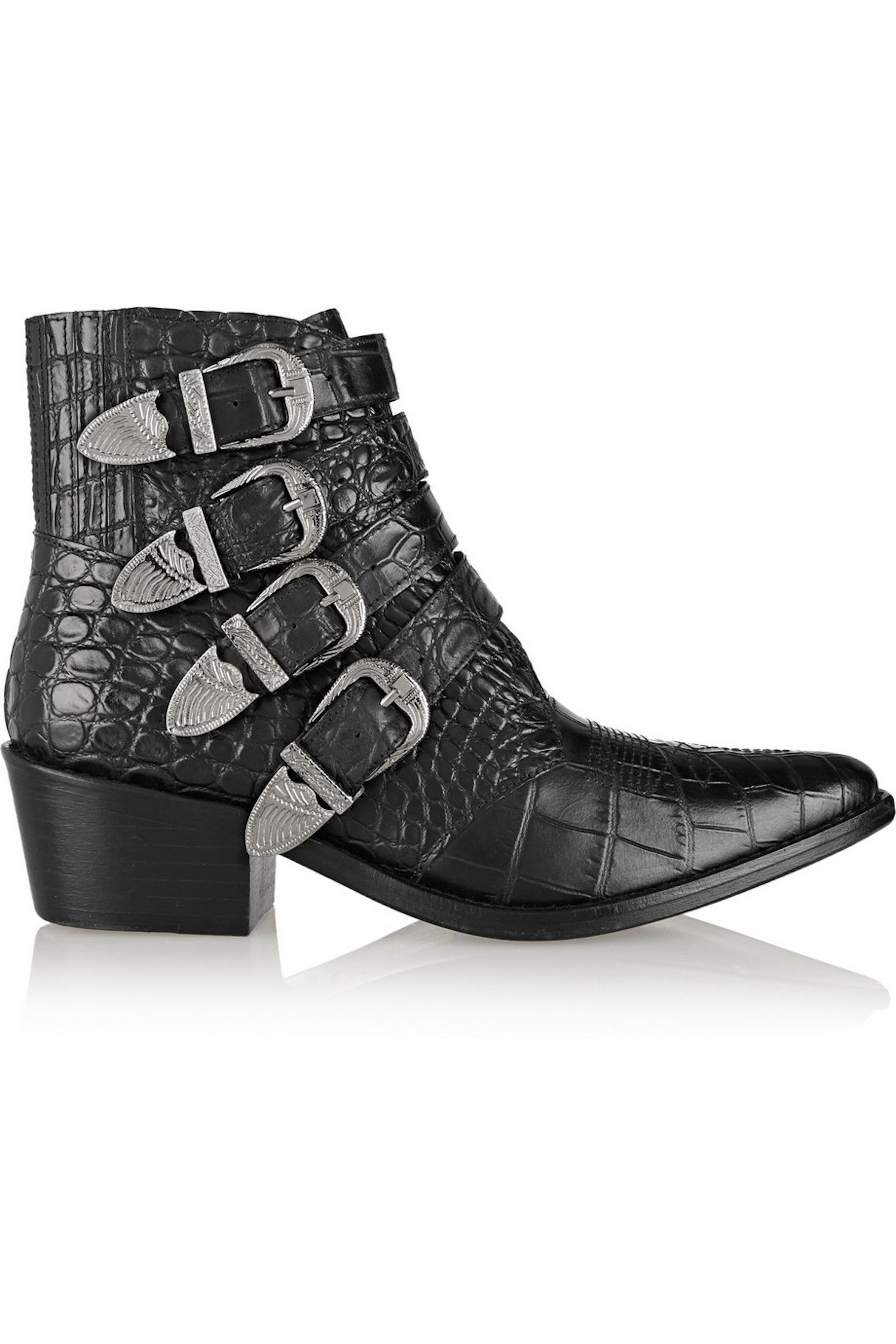 "<p>Saddle up in this rocker version of a Western shoe. The traditional cowboy style is modernized with a faux animal skin texture, Cuban heel and stand-out silver buckles. Yeehaw!</p><p><em>Toga Pulla Croc-Effect Leather Ankle Boots, $445, <strong><a href=""http://www.farfetch.com/shopping/women/toga-pulla-embossed-buckled-boots-item-11140292.aspx?storeid=9003&ffref=lp_57_10_"" target=""_blank"">farfetch.com</a>.</strong></em></p>"
