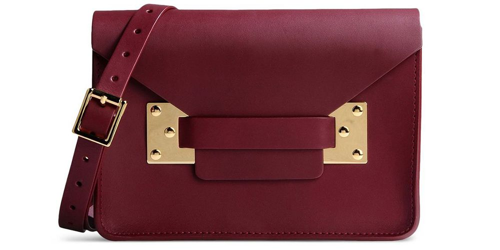 """<p><strong>Sophie Hulme</strong> bag, $560, <a href=""""https://shop.harpersbazaar.com/designers/s/sophie-hulme/dark-red-leather-clutch-5156.html"""" target=""""_blank""""><strong>shopBAZAAR.com</strong></a>. </p>"""