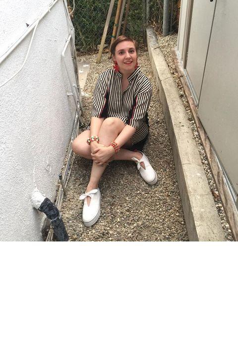 Sitting, Knee, Street fashion, Door, Foot, Slipper, Walking shoe,