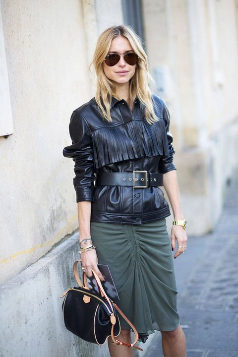 <p>The in-between-seasons coverup gets an update by way of fringe detailing. Make like Pernille Teisbaek and belt yours for a flattering silhouette. </p>