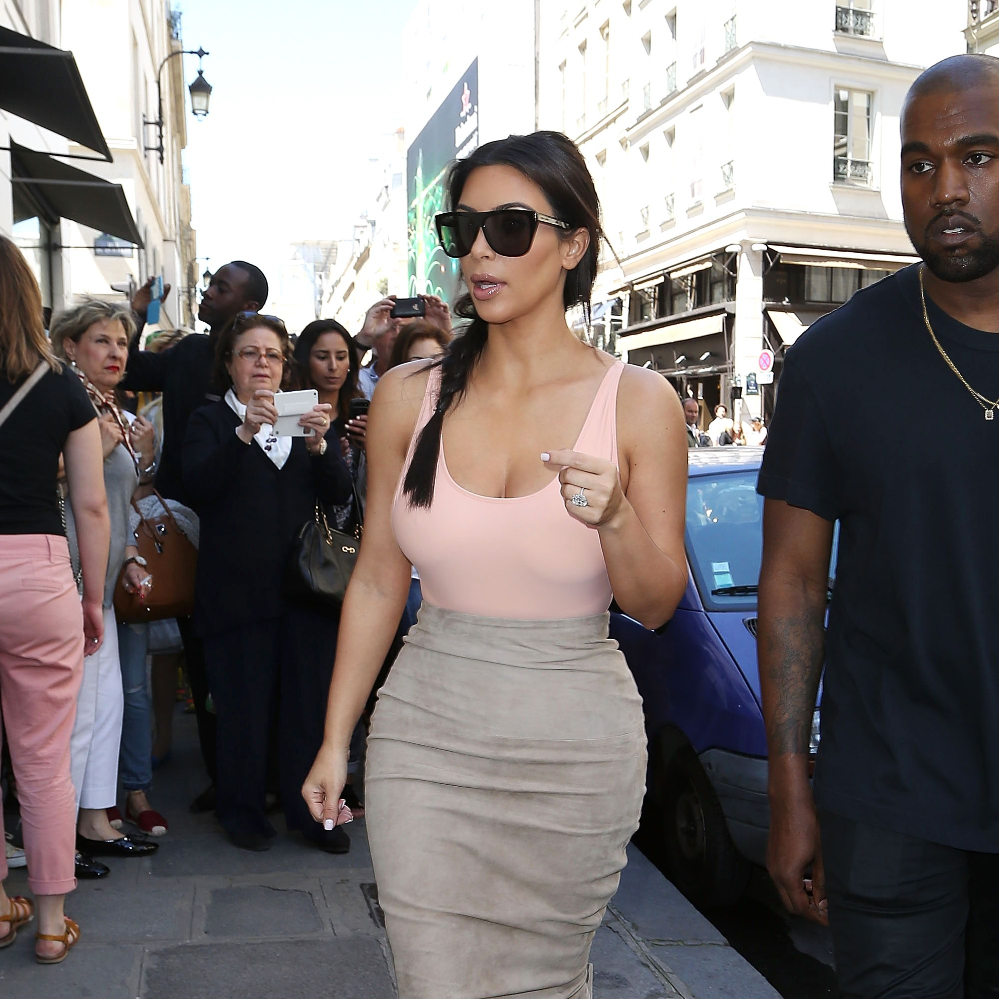 <p>Kim Kardashian delivers minimalism with major sex appeal by keeping her silhouettes body-skimming and her color palettes muted. Recreate her sultry, streamlined aesthetic with a bodysuit tucked into a skirt that hugs the curves from high-waist to knee-length hem—both in subdued neutral hues, of course. </p>
