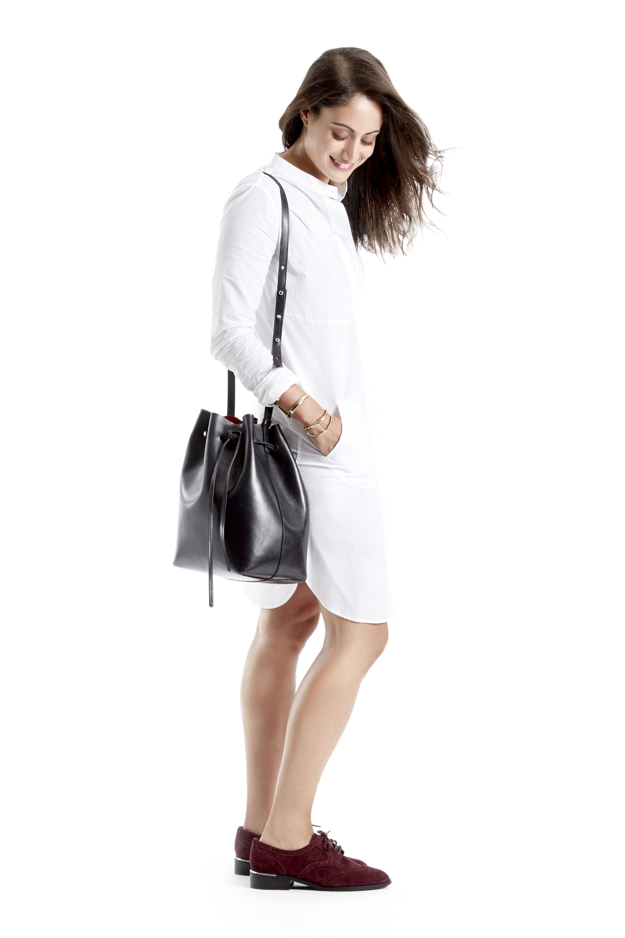 """<p>A day of hitting boutiques on the cobblestone streets calls for serious comfort. """"There's an amazing, energy downtown,"""" says Michelle Fawbush, senior merchandising editor for <em>Harper's Bazaar</em>. """"Classic New York calls for a classic outfit."""" Pair a crisp white shirt dress, an oxford shoe in a pop of color and a stylish bucket bag together for a menswear-inspired look. It's simple, understated and ideal for slipping on and off while trying on clothes.   </p>"""