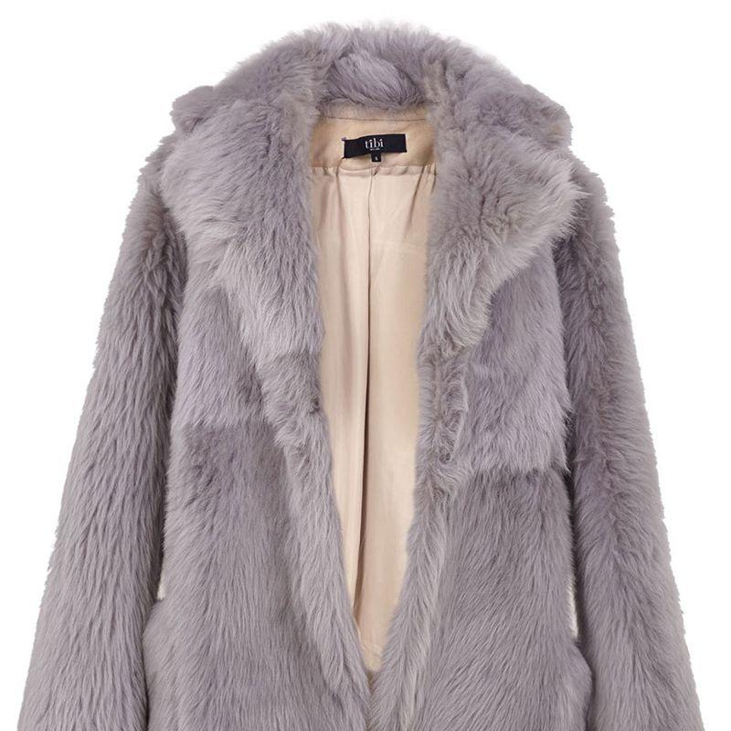 "<p><strong>Tibi</strong> coat, $3,200, <strong><a href=""https://shop.harpersbazaar.com/Designers/T/Tibi/Shearling-Toscana-Peacoat-5835.html"" target=""_blank"">shopBAZAAR.com</a></strong>. </p>"