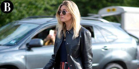 Eyewear, Vision care, Glasses, Sunglasses, Street fashion, Vehicle door, Jacket, Blond, Leather, Brown hair,