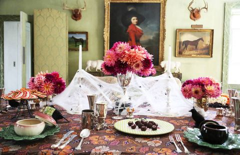 <p>When draped over huge vintage candlesticks and accented with berry colored dahlias.</p>