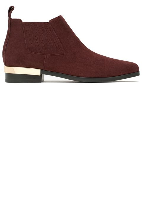 "<p><strong>Zara</strong> boot, $70, <a href=""http://www.zara.com/us/en/woman/shoes/view-all/flat-leather-ankle-boots-with-metal-plaque-c734142p2774924.html"" target=""_blank"">zara.com</a>.</p>"