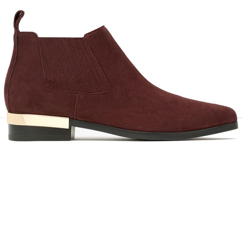 """<p><strong>Zara</strong> boot, $70, <a href=""""http://www.zara.com/us/en/woman/shoes/view-all/flat-leather-ankle-boots-with-metal-plaque-c734142p2774924.html"""" target=""""_blank"""">zara.com</a>.</p>"""