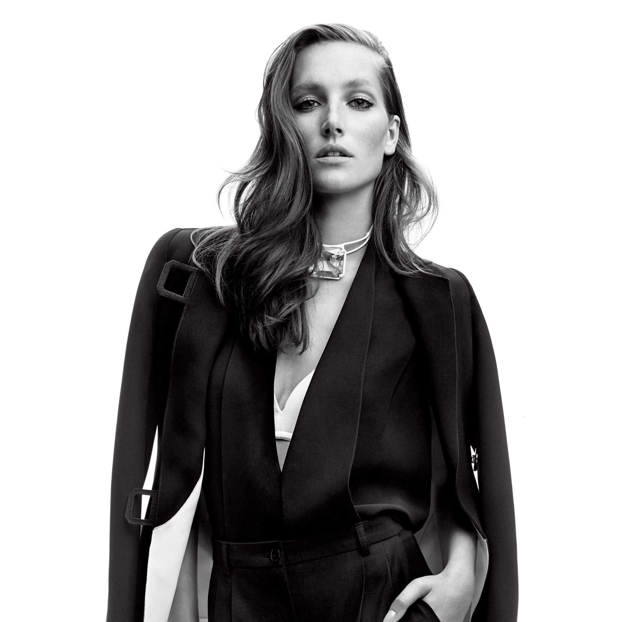 """<p><strong>Giorgio Armani</strong> jacket, $5,795, vest, $2,725, and pants, $1,175, 212-988-9191&#x3B; <strong>Wolford </strong>bra, $150, <a href=""""http://company.wolford.com/?lang=en"""" target=""""_blank"""">wolford.com</a>&#x3B; <strong>Rosie Assoulin </strong>choker, $695, Fivestory New York: 212-288-1338.</p><p><strong>BEAUTY BAZAAR</strong> For instant volume, spritz your strands with Not Your Mother's Haircare Double Take Dry Finish Texture Spray, $7, <a href=""""http://www.ulta.com/ulta/browse/productDetail.jsp?productId=xlsImpprod12041711"""" target=""""_blank"""">ulta.com</a>.</p>"""
