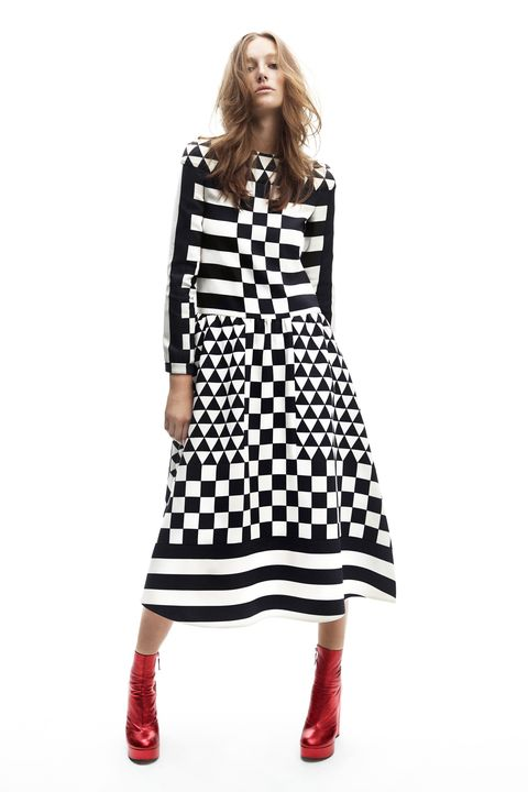 <p><strong>Valentino</strong> dress, $5,290, 212-355-5811; <strong>Marc Jacobs</strong> boots, $1,150, 212-343-1490.</p>