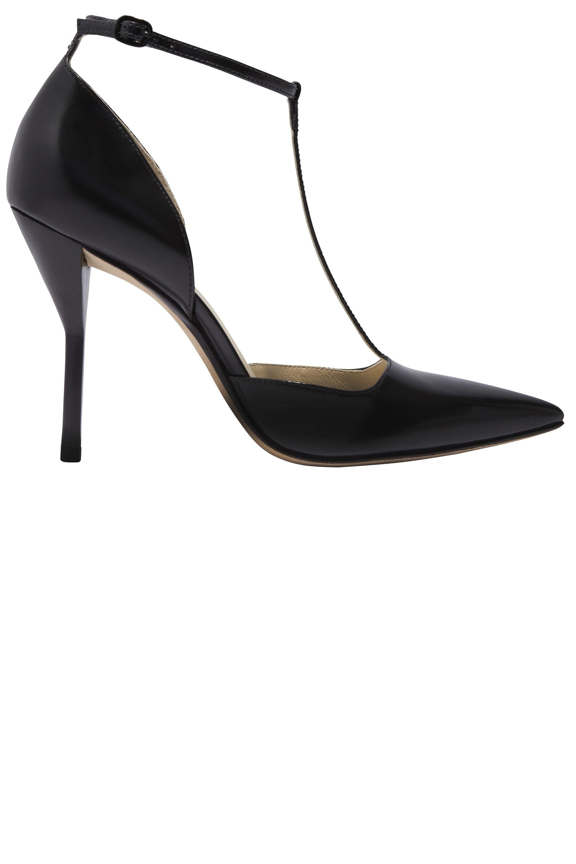 """<p><strong>3.1 Phillip Lim </strong>shoe, $450, <a href=""""https://shop.harpersbazaar.com/designers/3-1-phillip-lim/martini-leather-t-strap-pump/"""" target=""""_blank"""">shopBAZAAR.com</a> <img src=""""http://assets.hdmtools.com/images/HBZ/Shop.svg"""" class=""""icon shop"""">.</p>"""