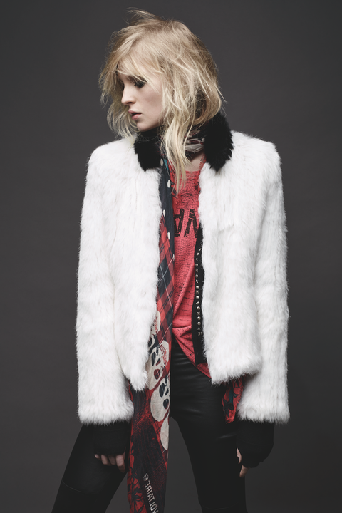 "<p>Black, skinnies, a vintage-looking T, and punk details don't immediately telegraph upscale, but add a milk-white fur coat (this one pops with a black collar), and suddenly the look is all grown up. ""White is so iconic,"" Bönström says. ""White on as strong a piece as a fur jacket makes it 100 percent rock."" </p>"