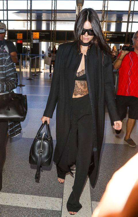 <p>Kendall Jenner, the reigning queen of model-off-duty style, breaks up a head-to-toe ensemble with a hint of skin through her lace camisole—taking airport style to sultry new heights.</p>